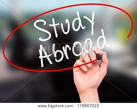 Man Hand Writing Study Abroad With Black Marker On Visual Screen