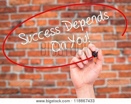 Man Hand Writing Success Depends On You! With Black Marker On Visual Screen