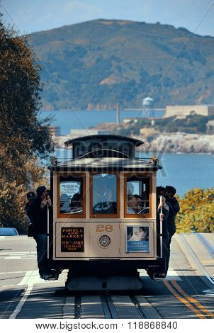 San Francisco, CA - MAY 11: Cable car in street on May 11, 2014 in San Francisco. It is the world's last manually-operated cable car system