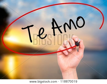 Man Hand Writing Te Amo ( I Love You In Spanish)  With Black Marker On Visual Screen