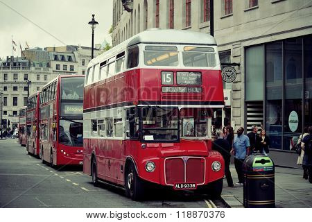 LONDON, UK - SEP 27: Vintage red bus in street on September 27, 2013 in London, UK. London is the world's most visited city and the capital of UK.
