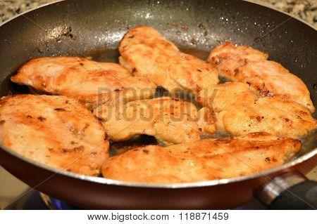 Frying breaded chicken meat
