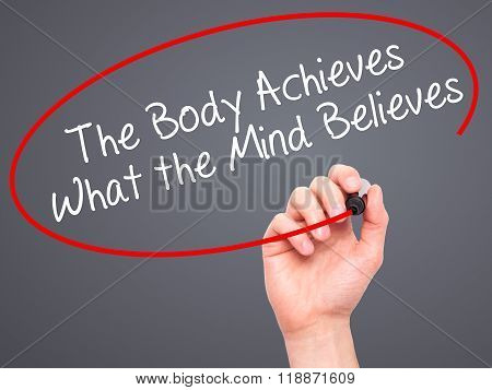 Man Hand Writing The Body Achieves What The Mind Believes With Black Marker On Visual Screen