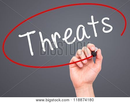 Man Hand Writing Threats With Black Marker On Visual Screen