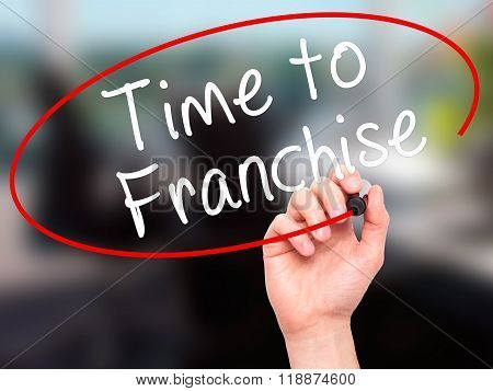 Man Hand Writing Time To Franchise With Black Marker On Visual Screen