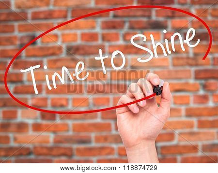 Man Hand Writing Time To Shine With Black Marker On Visual Screen