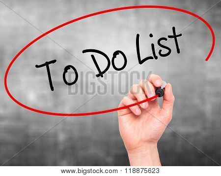 Man Hand Writing To Do List With Black Marker On Visual Screen