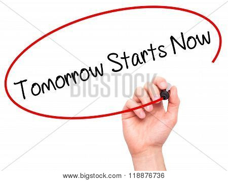 Man Hand Writing Tomorrow Starts Now With Black Marker On Visual Screen