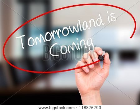 Man Hand Writing Tomorrowland Is Coming With Black Marker On Visual Screen