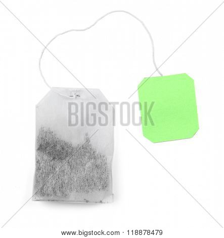 Teabag with green label isolated on white background