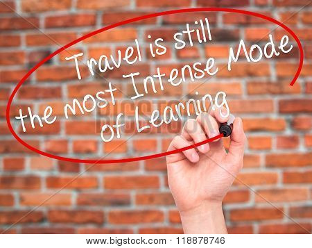 Man Hand Writing Travel Is Still The Most Intense Mode Of Learning With Black Marker On Visual Scree