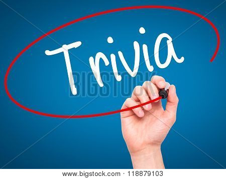 Man Hand Writing Trivia With Black Marker On Visual Screen