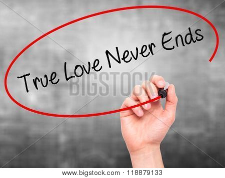 Man Hand Writing True Love Never Ends With Black Marker On Visual Screen