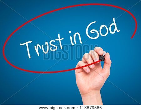 Man Hand Writing Trust In God With Black Marker On Visual Screen
