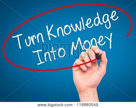 Man Hand Writing Turn Knowledge Into Money With Black Marker On Visual Screen