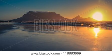 Beautiful sunset at Milnerton beach ,showing the Table Mountain, Cape Town, South Africa