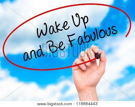 Man Hand Writing Wake Up And Be Fabulous With Black Marker On Visual Screen