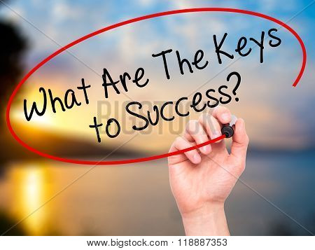Man Hand Writing What Are The Keys To Success? With Black Marker On Visual Screen