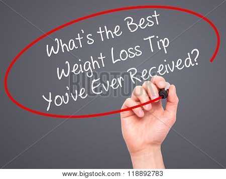 Man Hand Writing Whats The Best Weight Loss Tip You've Ever Received? With Black Marker On Visual Sc