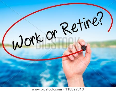 Man Hand Writing Work Or Retire? With Black Marker On Visual Screen
