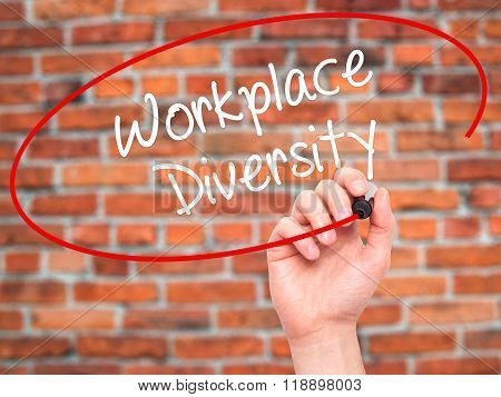 Man Hand Writing Workplace Diversity  With Black Marker On Visual Screen
