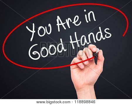 Man Hand Writing You Are In Good Hands With Black Marker On Visual Screen