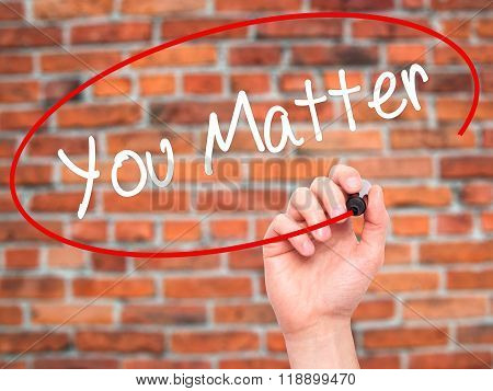 Man Hand Writing You Matter With Black Marker On Visual Screen