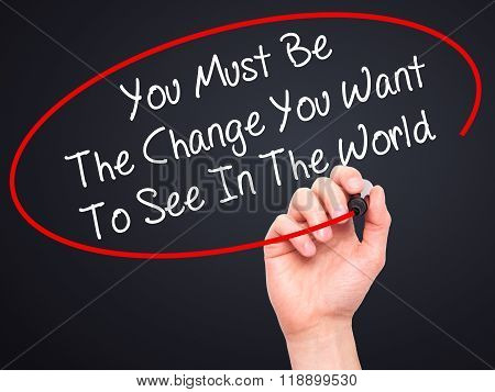 Man Hand Writing You Must Be The Change You Want To See In The World With Black Marker On Visual Scr