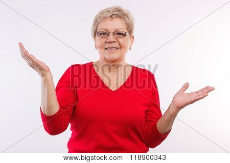 Happy Elderly Woman Shrugging Shoulders And Throwing Up Her Hands, Emotions In Old Age