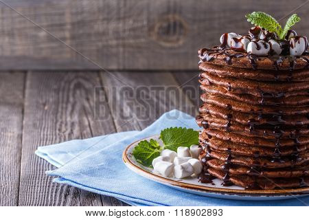 Stack Of Pancakes With Marshmallow And Chocolate Syrup.