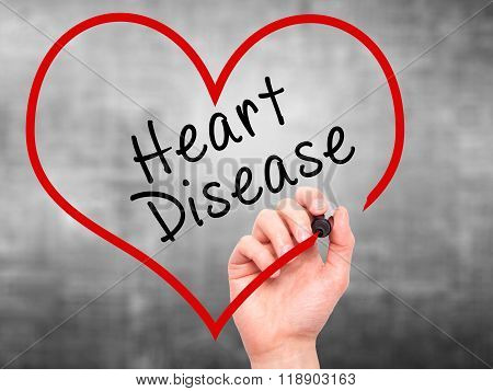 Man Hand Writing Heart Disease With Marker On Transparent Wipe Board
