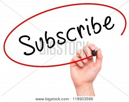 Man Hand Writing Subscribe With Marker On Transparent Wipe Board