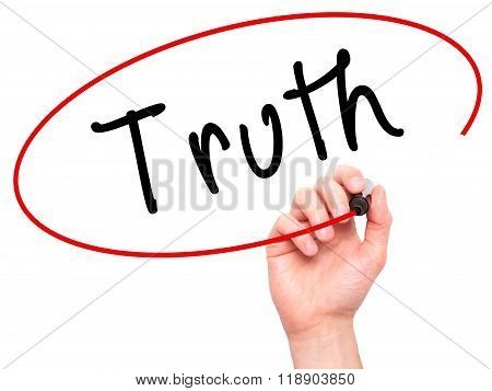 Man Hand Writing Truth With Marker On Transparent Wipe Board
