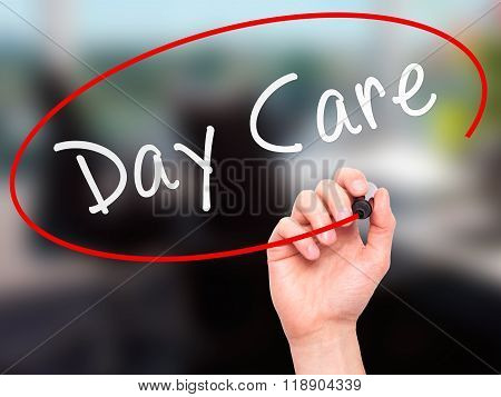 Man Hand Writing Day Care With Marker On Transparent Wipe Board Isolated On Office