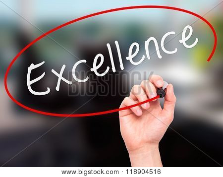 Man Hand Writing Excellence With Marker On Transparent Wipe Board Isolated On Office