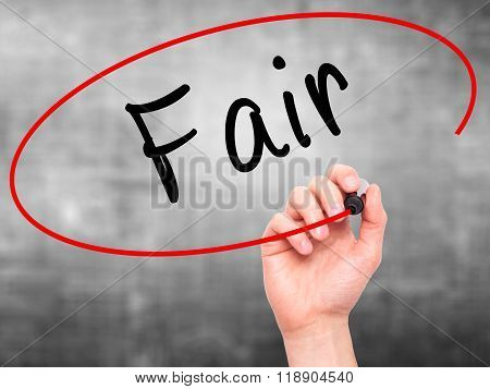 Man Hand Writing Fair With Black Marker On Visual Screen