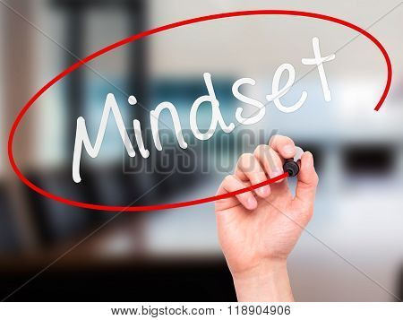 Man Hand Writing Mindset With Marker On Transparent Wipe Board Isolated On Office