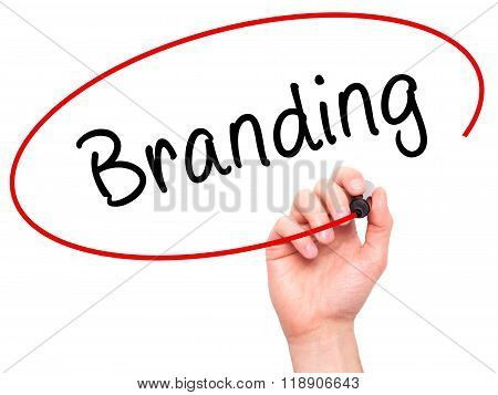 Man Hand Writing Branding With Marker On Transparent Wipe Board