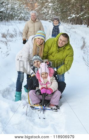 family  in winter with  snowmobile