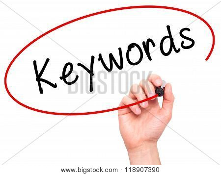 Man Hand Writing Keywords On Visual Screen