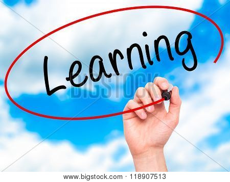 Man Hand Writing Learning With Marker On Transparent Wipe Board