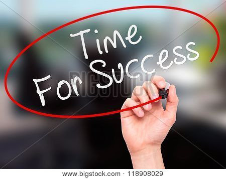 Man Hand Writing Time For Success With Marker On Transparent Wipe Board