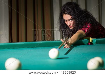 Young Attractive Brunette Woman Playing Billiards