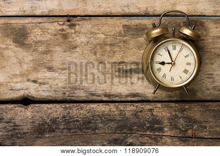 Old Fashioned Alarm Clock On Wooden Background