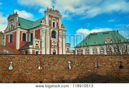 Baroque Catholic Church behind medieval defensive wall