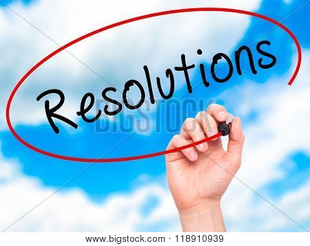 Man Hand Writing Resolutions On Visual Screen