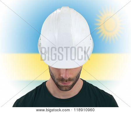 Engineer With Flag On Background - Rwanda