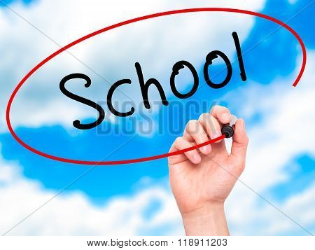 Man Hand Writing School With Marker On Transparent Wipe Board