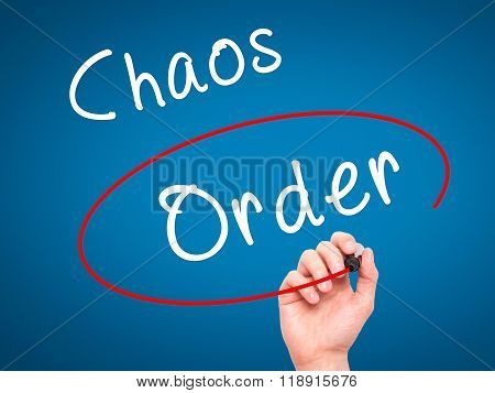 Man Hand Writing And Choosing Order Instead Of Chaos With Black Marker On Visual Screen