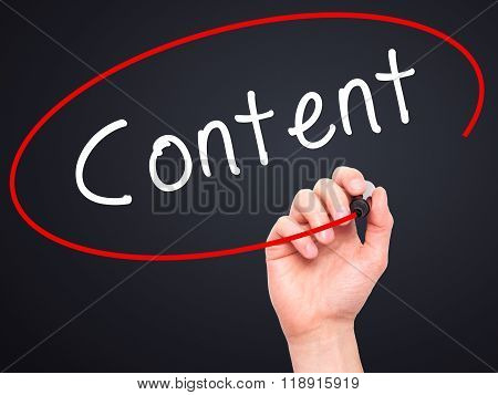 Man Hand Writing Content With Black Marker On Visual Screen